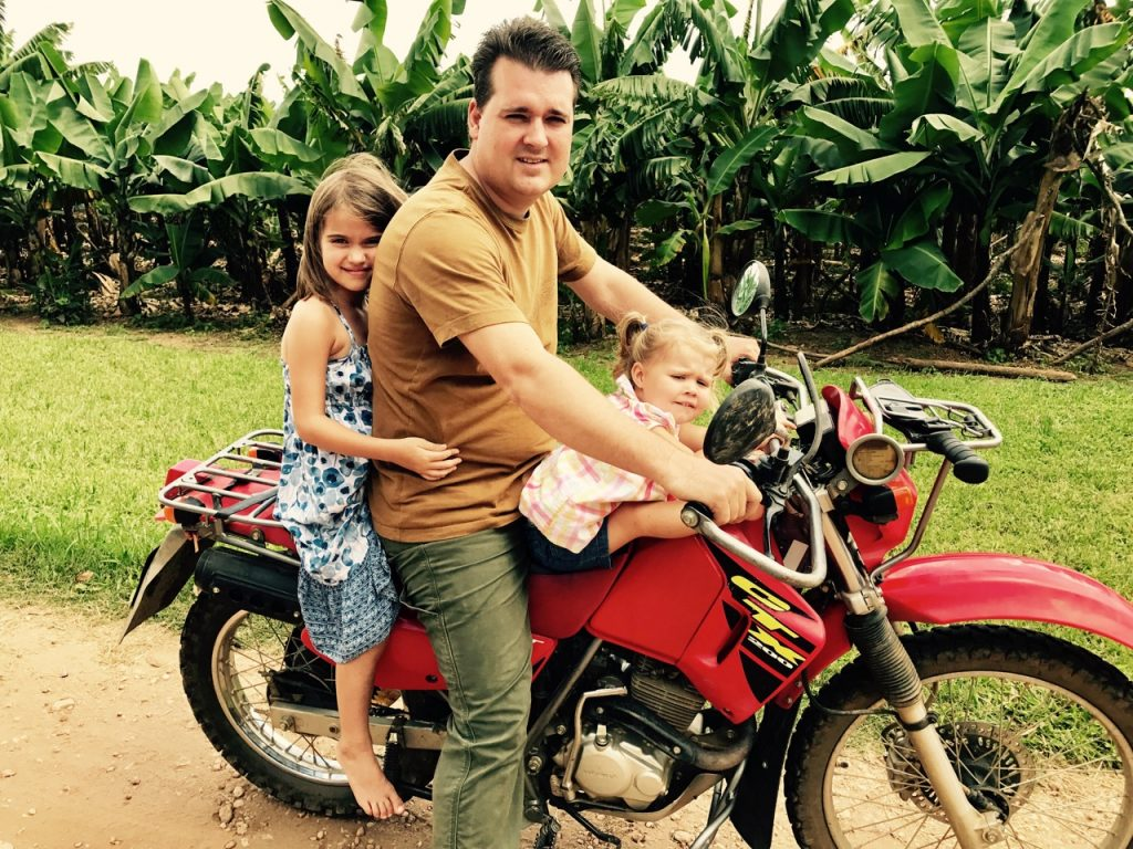 Craig with girls on motorcycle
